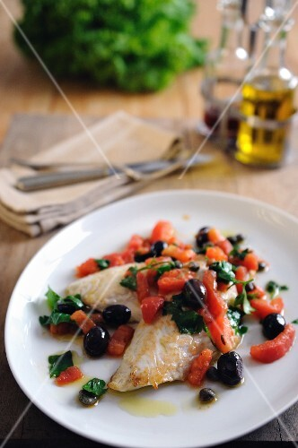Pan fried fillets of John Dory with baby plum tomatoes and black olives and capers
