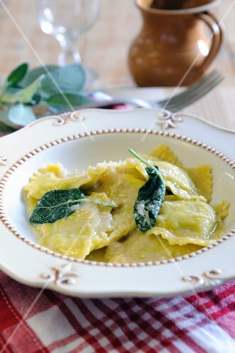 Spinach and ricotta filled ravioli with sage butter