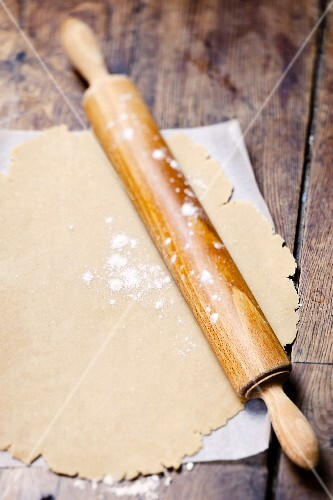 Rolled-out spelt dough with a rolling pin