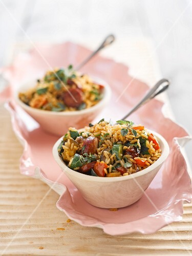 Paella with chorizo and fried vegetables