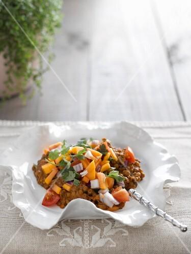 Lentil curry with papaya salsa