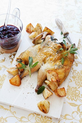 Spring chicken with sage and berry Port wine sauce for Christmas dinner