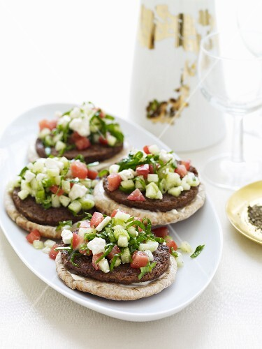 Lamb Burgers on Pita Bread Topped with Feta and Tomatoes