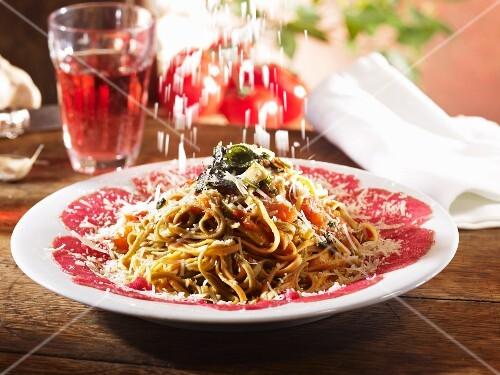 Taglierini with beef carpaccio, tomatoes, sage and Parmesan