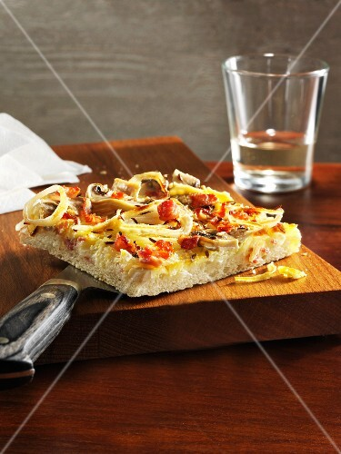 Onion tart with mushrooms and bacon