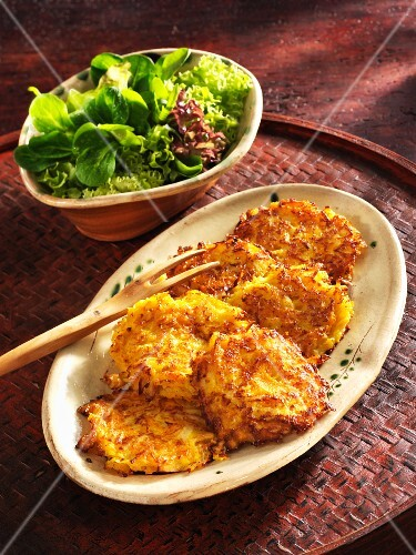 Parsnip and pumpkin cakes with a side salad