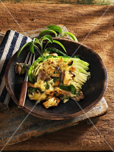 Gratinated savoy cabbage with sage and mushrooms