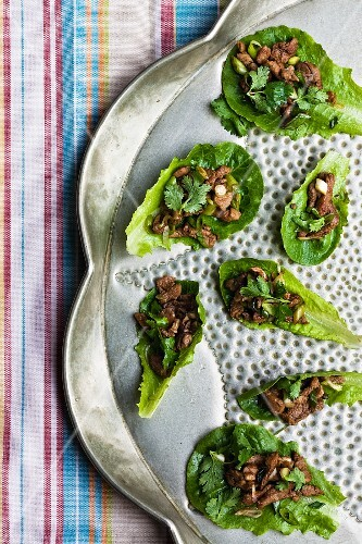 Pork and coriander on lettuce leaves