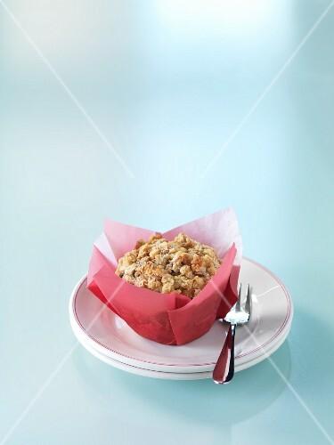 Plum muffins in paper on a dessert plate