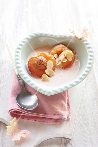 Nectarines poached in rooibos tea, in rosewater custard