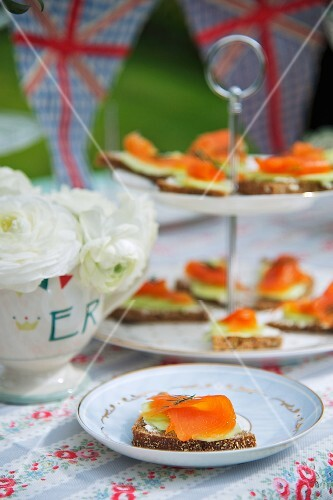 Canapes with smoked salmon and cucumber for a Jubilee party (England)
