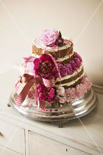 Multi-layer wedding cake decorated with pink flowers and ribbons