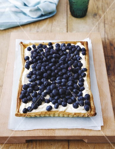 A puff pastry tart with lavender cream and blueberries