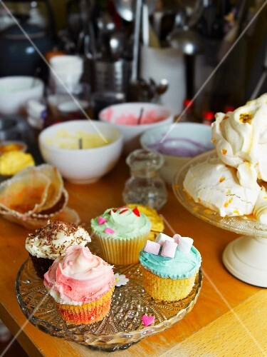 Decorated cupcakes and meringues in a kitchen