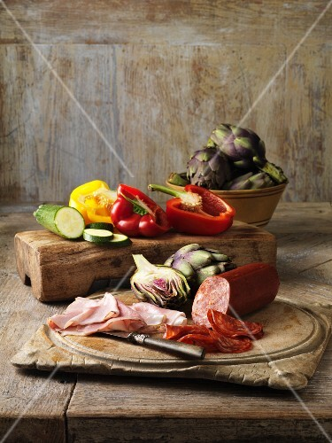 Vegetables and meats on wooden board