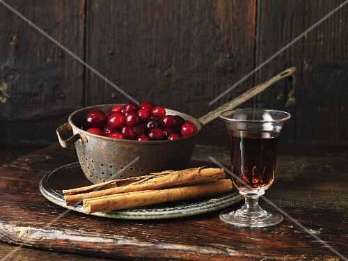 Cranberries, sherry, and cinnamon sticks