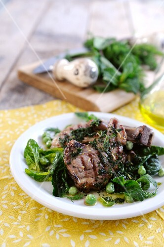 Lamb chops with a spinach and pea salad and parsley sauce