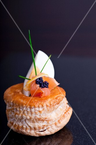 A vol-au-vent filled with egg, smoked salmon and lumpfish caviar