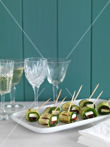 Grilled courgette rolls with feta and dried tomatoes