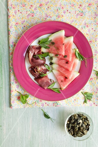 Watermelon with beef and pumpkin seeds