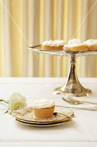 Cupcakes with lemon meringue on a plate and on a cake stand