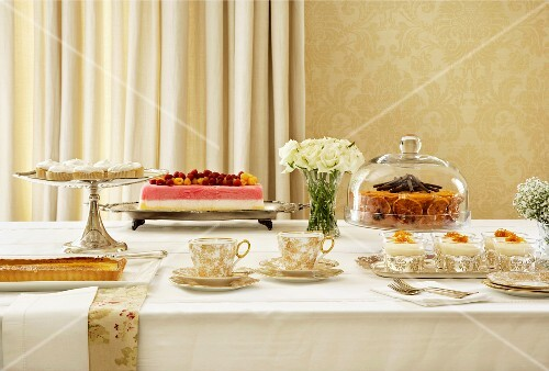 A buffet of assorted cakes and desserts