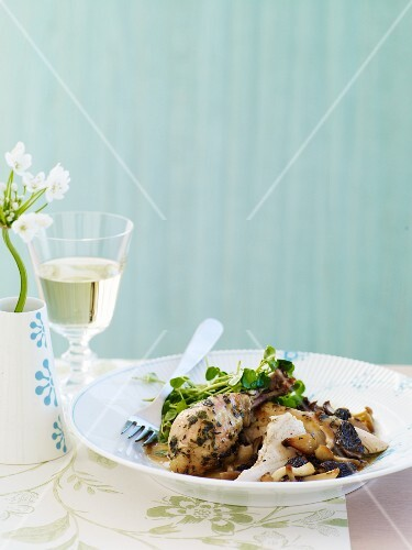 Chicken with Mushrooms Sauce in a Bowl; Glass of White Wine; Flowers