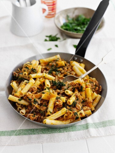 Pan of pasta with meat and herbs