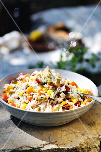 Rice salad with pepper, mushrooms, sweetcorn, carrots and olives