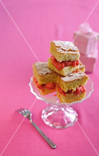 An ice cream sandwich made with lemon cake and strawberry ice cream