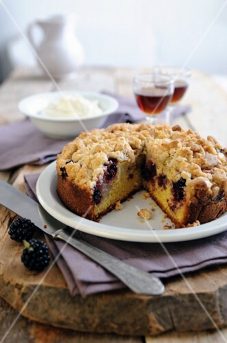 Crumble cake with blackberries and apples, sliced