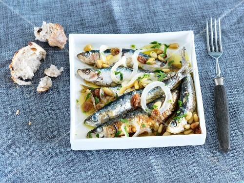 Marinated sardines with onions and pine nuts