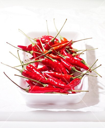 Fresh red chilli peppers in a bowl