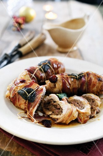 Turkey breast filled with sausage and chestnut puree wrapped in pancetta and sage leaves