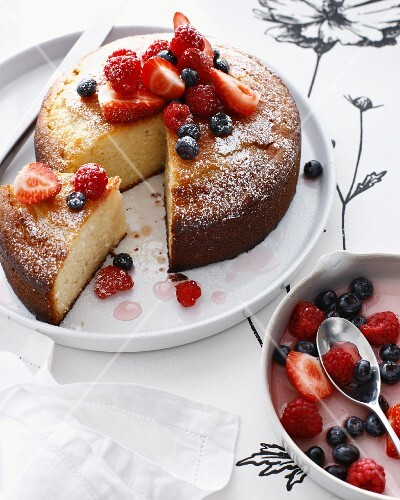 Plate of rose cake with berries