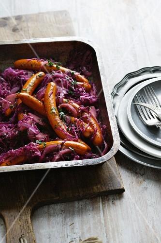 Dish of purple cabbage and frankfurters