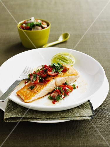 Plate of salmon with tomato salsa