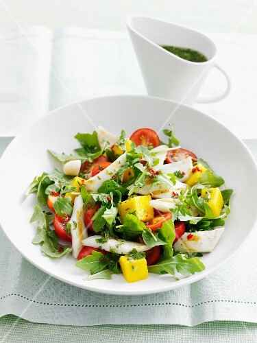 A summer salad with mango and squid