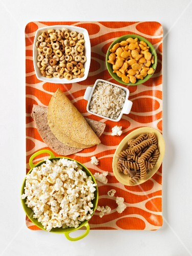 Assorted Grain Based Products: Taco Shells, Tortillas, Whole Grain Fusilli, Popcorn, Rice, Cereal and Goldfish Crackers