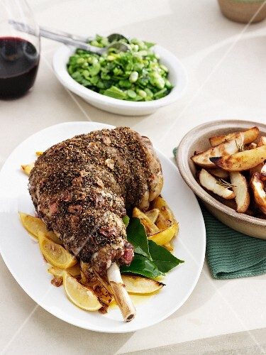 Plate of lamb with lemons and potatoes