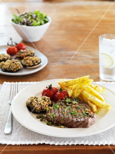 Beef steak with capers, gherkins and chips
