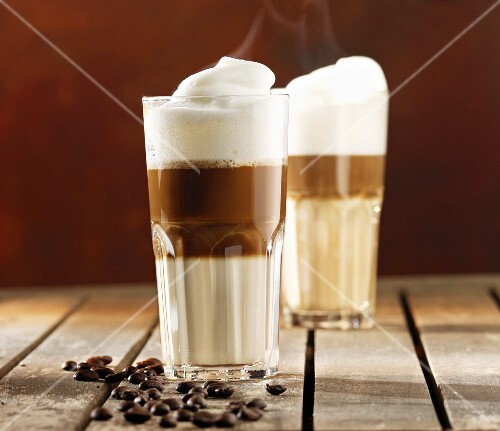 Two glasses of steaming latte macchiato