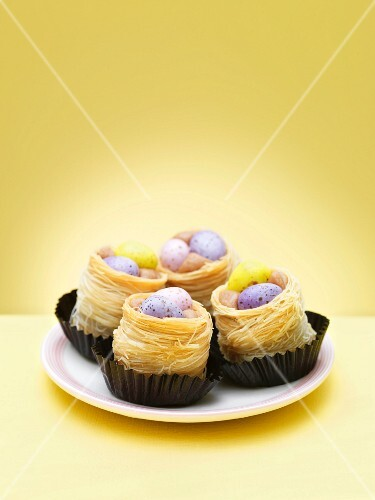 Chocolate eggs in decorative nests