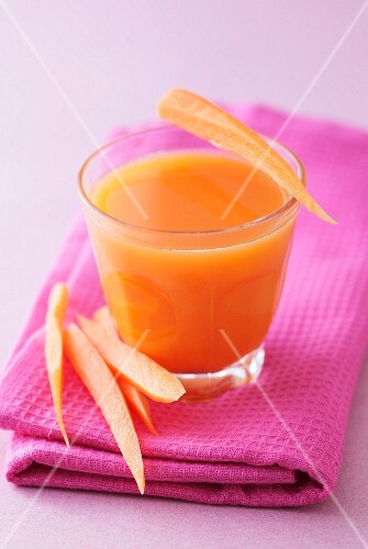 A glass of carrot and apple juice