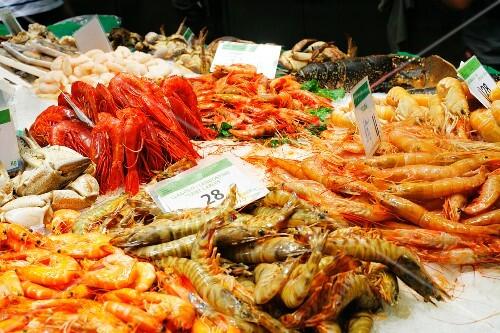 Shrimp, Langostino, Lobster, Crabs on Ice at the La Boqueria Market in Barcelona, Spain