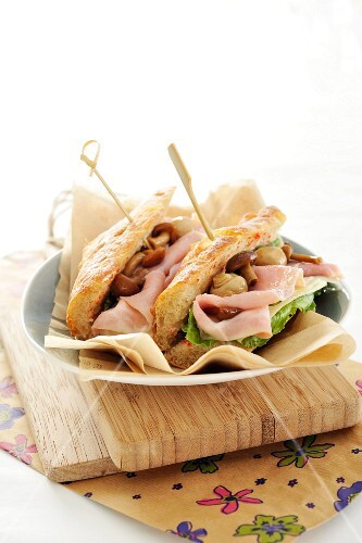 A ham and lettuce baguette with marinated mushrooms