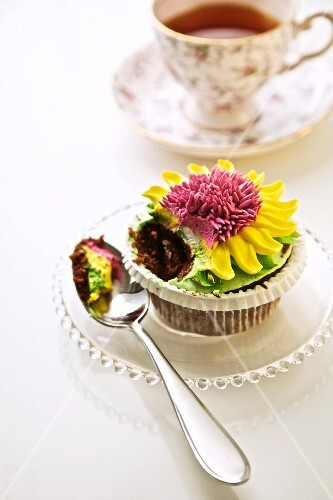 Flower Cupcake with a Scoop on a Spoon; Cup of Tea