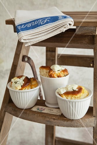 Three cheese soufflés on a stepladder