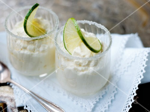 Lime yogurt cream in two glasses with sugared rims