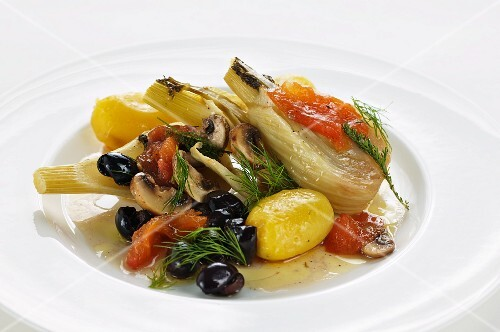 Fennel wrapped in foil cooked with olives, tomatoes and potatoes